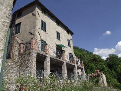 Large village house near Bagni di Lucca with road access and garden